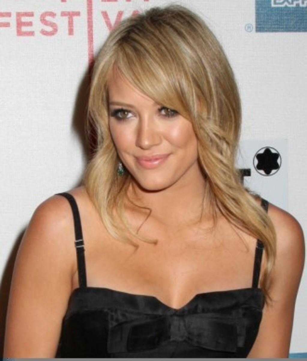 Medium-legnth layered haircut with side-swept bangs for thin hair.