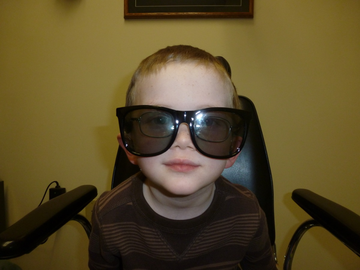 Poorly fitting glasses will not serve a child well. This picture is of my son wearing a pair of stereoscopic glasses to determine if he can see in three dimensions (he has amblyopia, and cannot perceive depth).