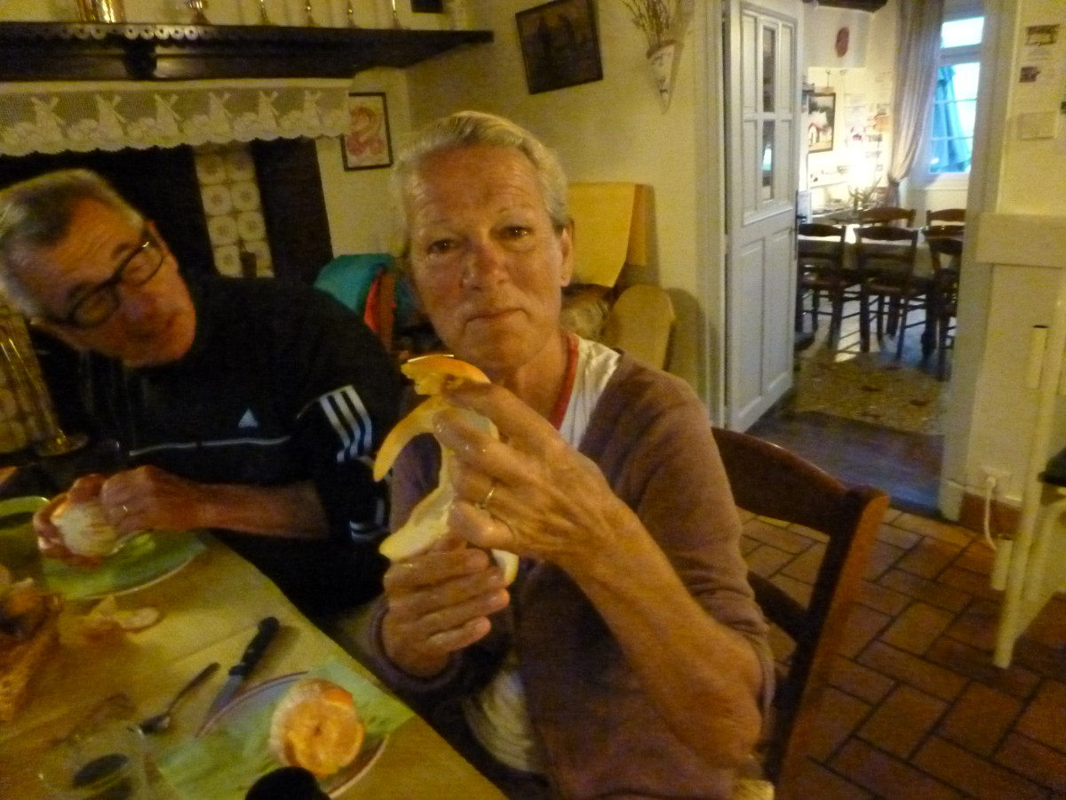 After dinner a French pilgrim shows us how to peel a baby boy from an orange.