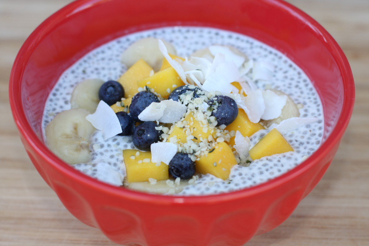 Chia seed tapioca pudding with COCONUT MILK, mangp, bananas, coconut flakes, blueberries.