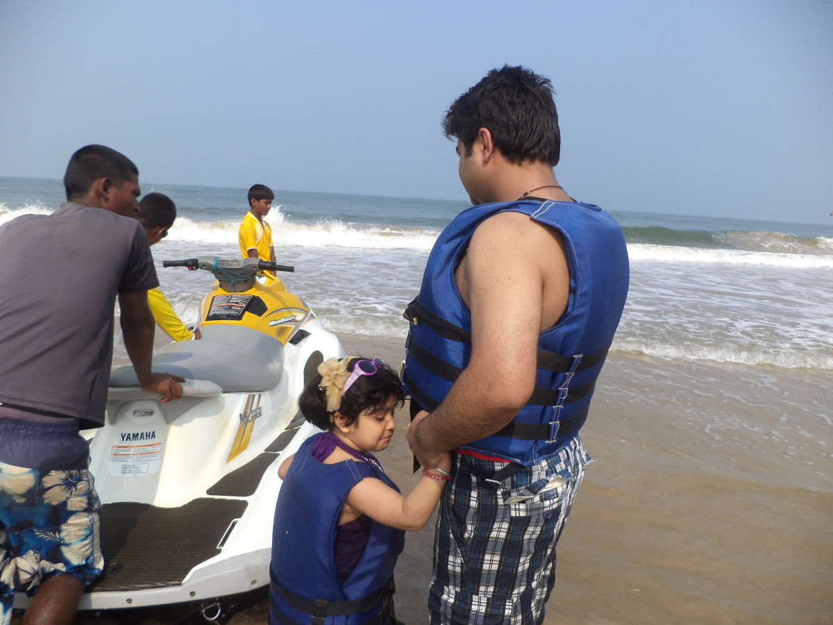 Myself with daughter getting ready for jet skiing at Calangute Beach in Goa.