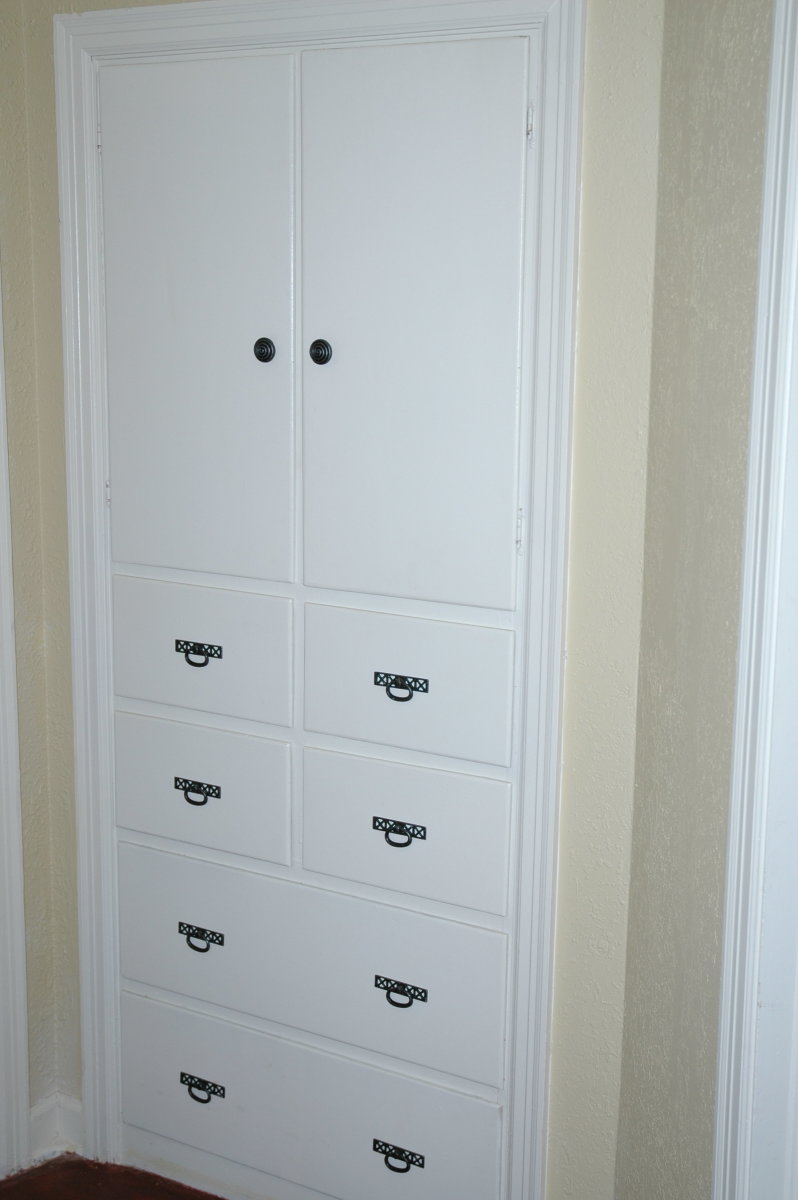 Built-in linen cabinet in the hallway was built with this older cottage.  New paint and hardware freshened it up.
