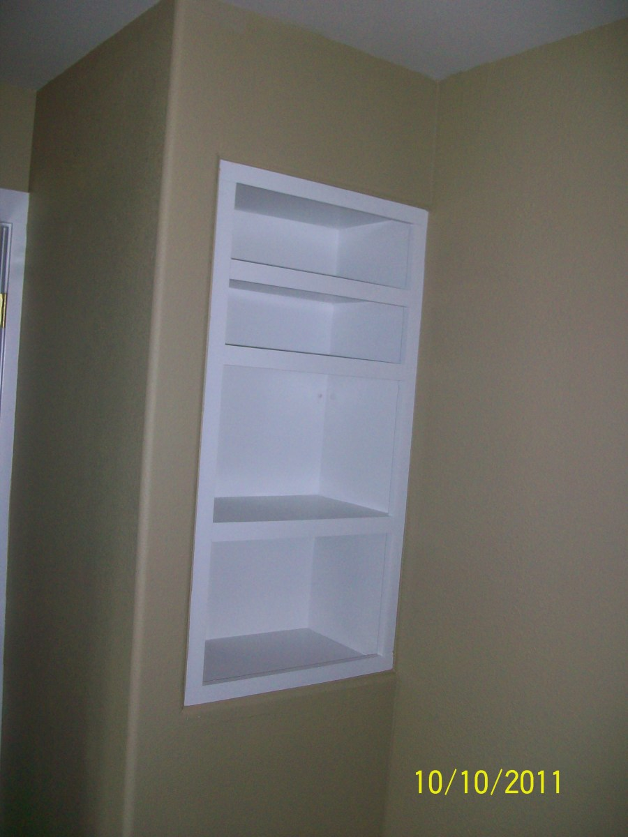 Built in shelving on the bedroom side of the same space above.