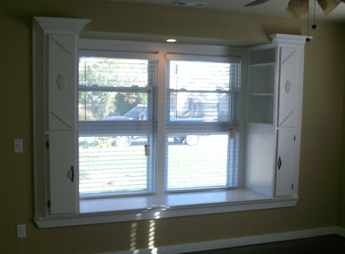 Wall bumped out to enlarge window and create hinged lid window seat - storage shelves were added on either end.