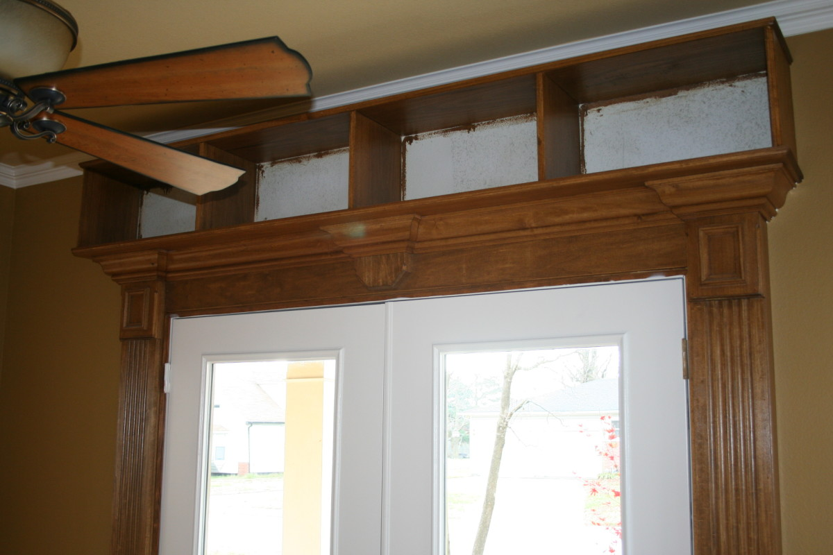 In the process of being stained, these bookshelves were added above a set of french doors in a study.