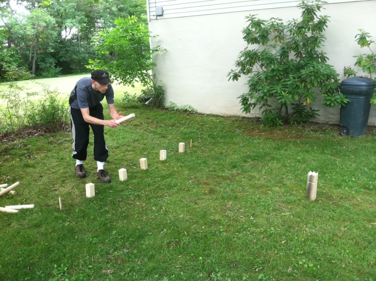 My roomate Dan playing KUBB June 16, 2012