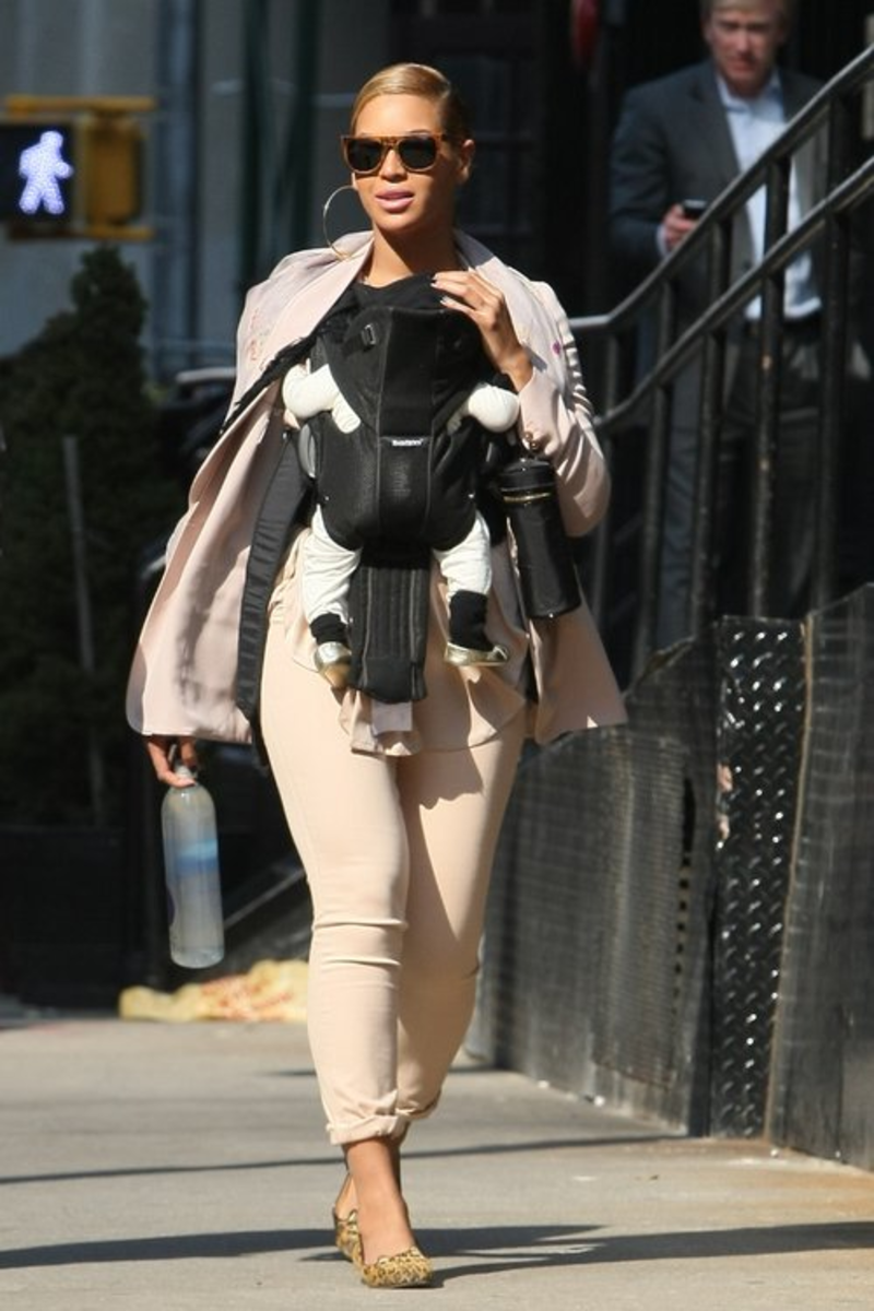 Beyonce wearing her daughter, Blue Ivy, at 2 months old.