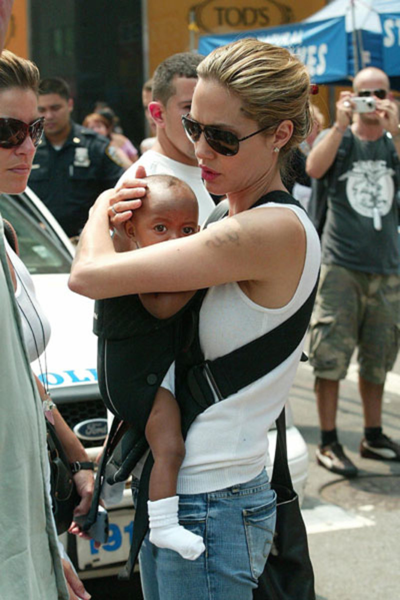 Angelina Jolie wearing her baby Zahara. Notice the resemblence. Actually she adopted some babies.