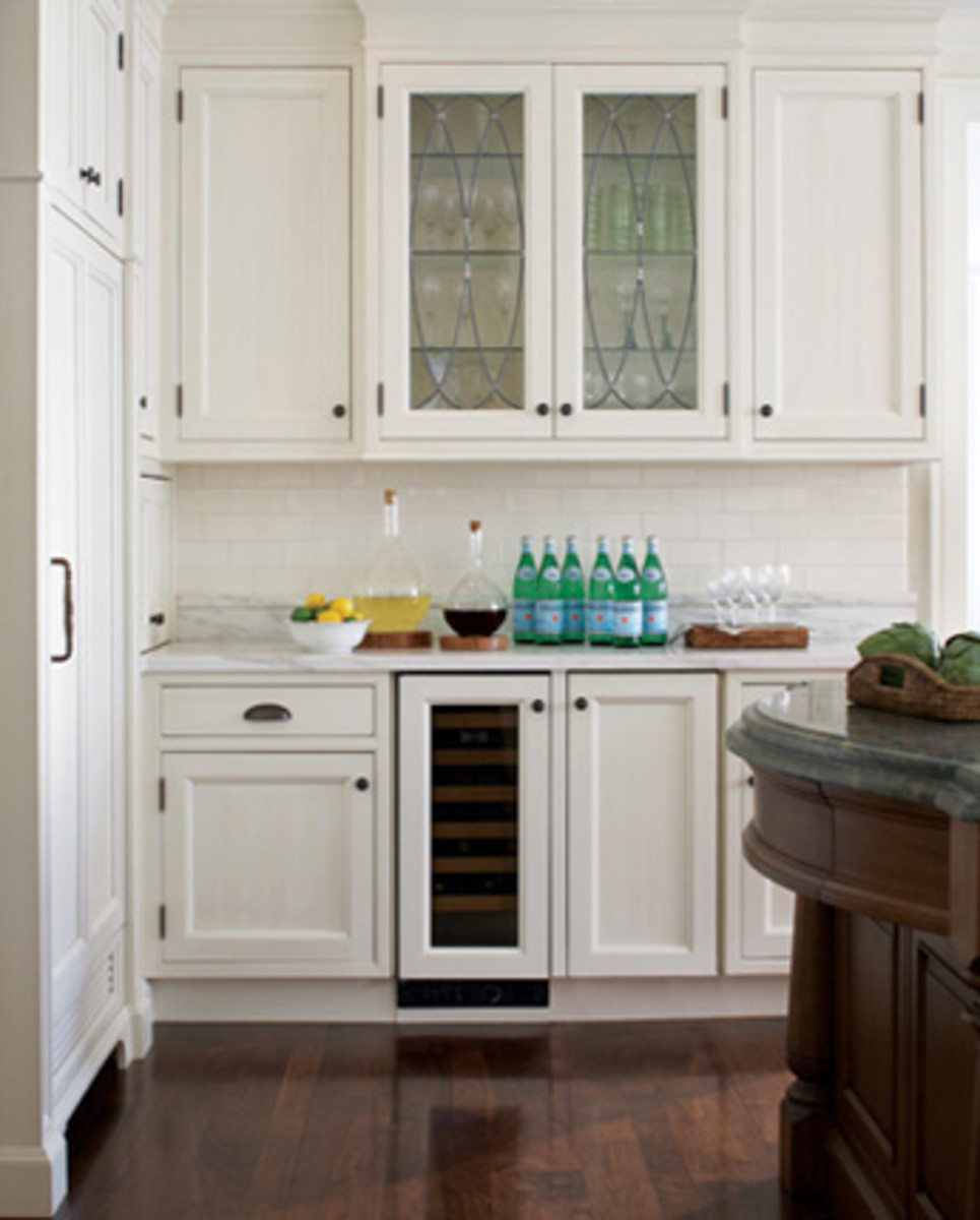 glass cabinet door add character to a classic white kitchen