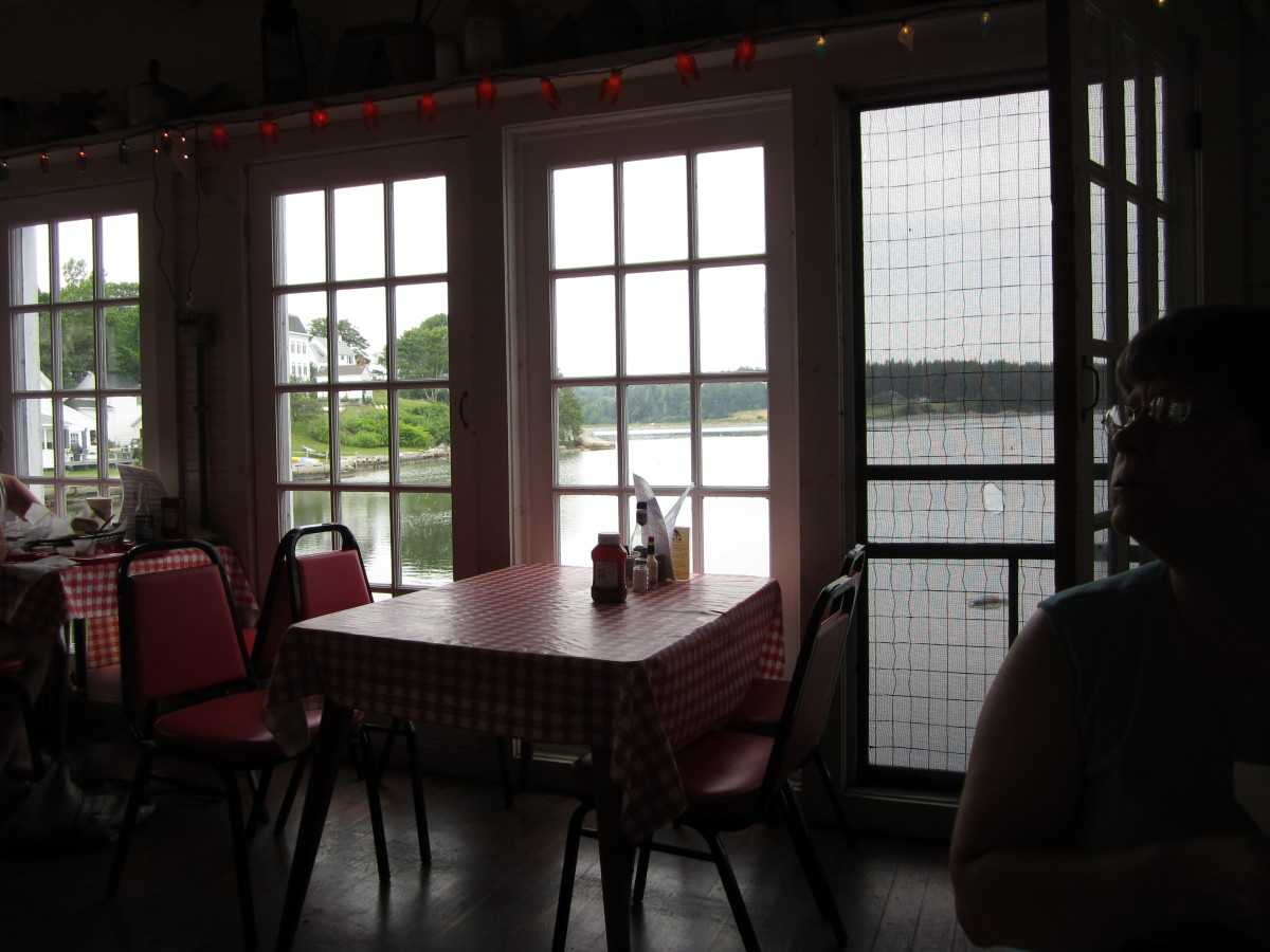 Tables next to the windows over looking Carvers Pond, The Harbor Gawker Restaurant.