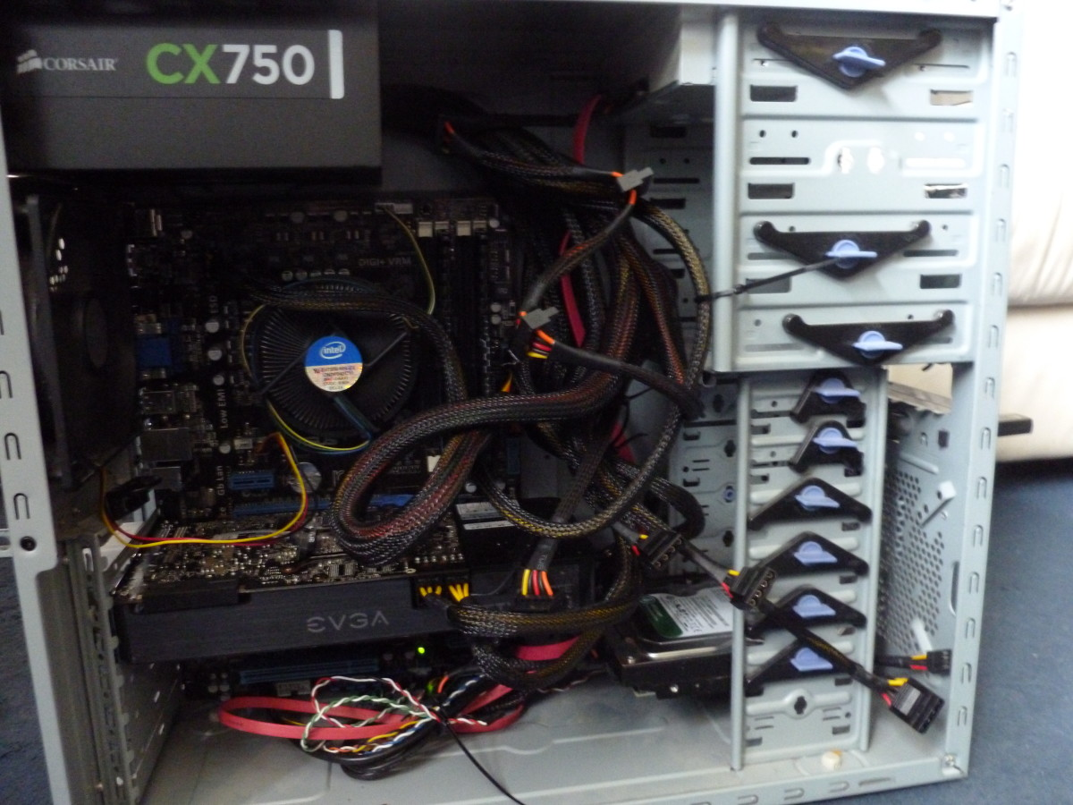 The inside of a desktop computer.  The processor, graphics card, RAM, hard drive and everything else neatly fitted together via the motherboard.