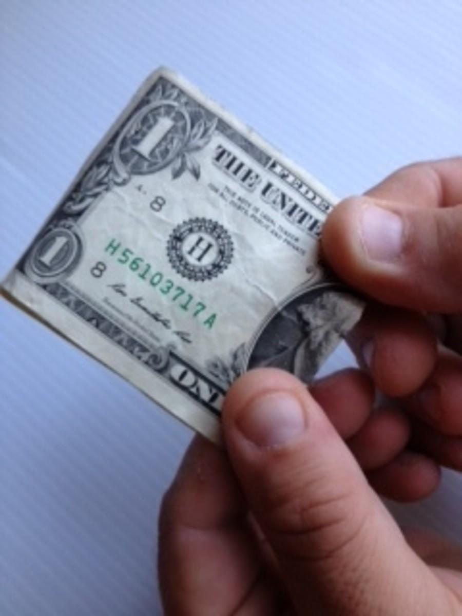1. Fold bill in half.