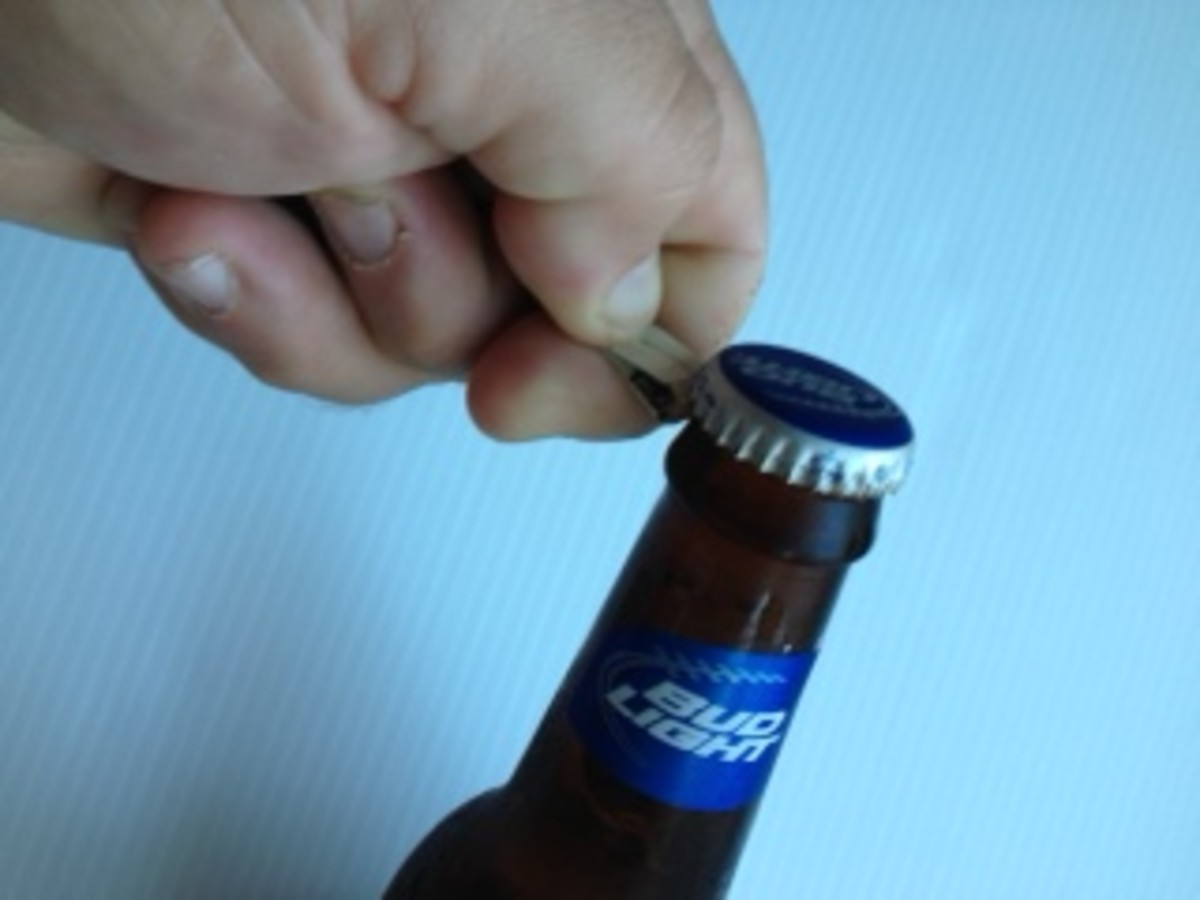 4. Place between thumb and forefinger, place firmly under cap.
