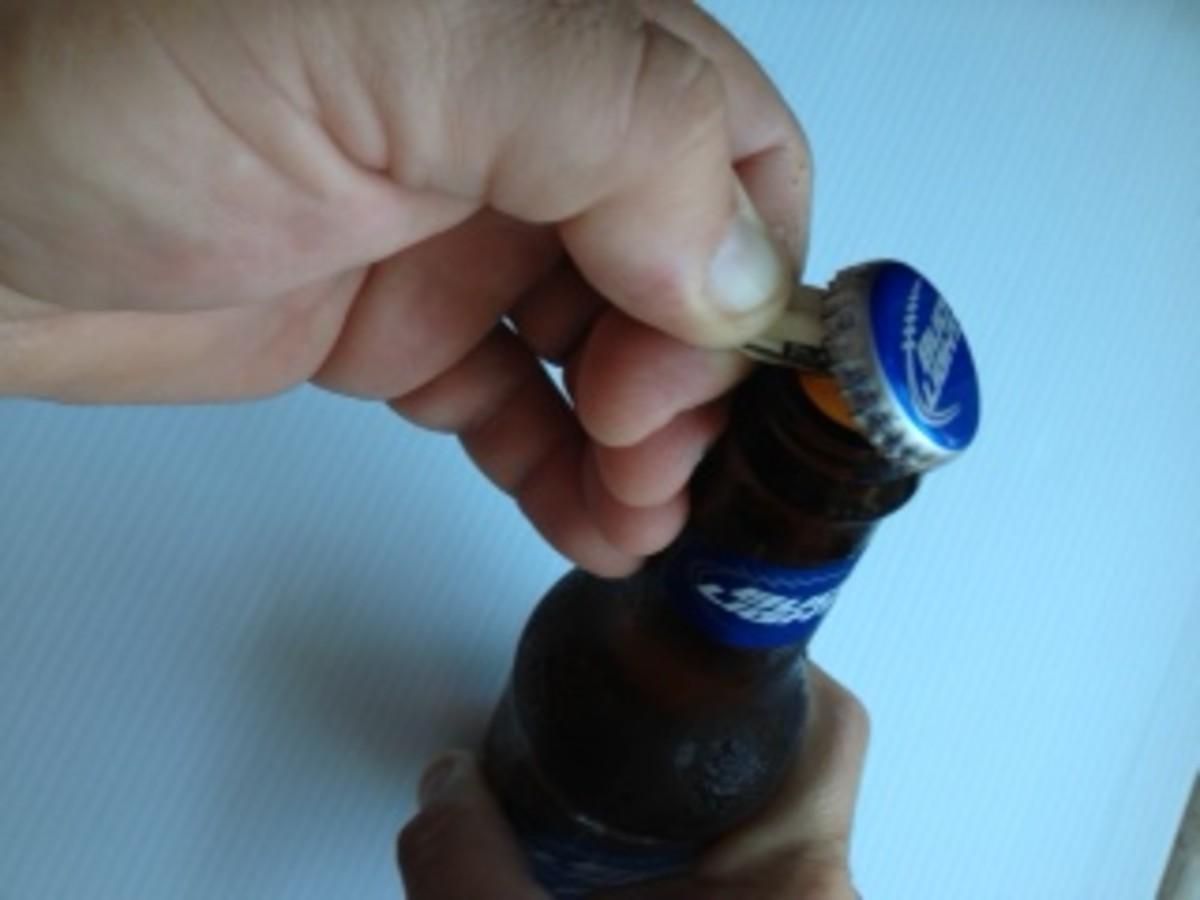 5. Create fulcrum with forefinger, apply pressure until cap pops off.