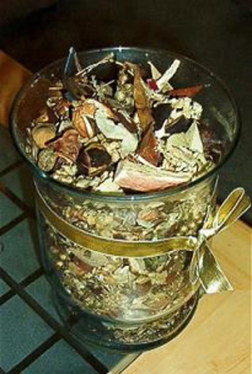 potpourri crock pots, glass bowls or wooden bowels are the best to use at home.
