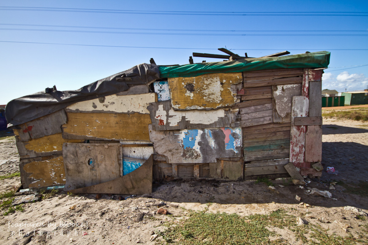 "Shanties are the cheapest way to live. The land is free and people usually build a shack with whatever scrap material is available around Langa or in nearby dumpsters. ""The oppressors do not favor promoting the community as a whole, but rather select"