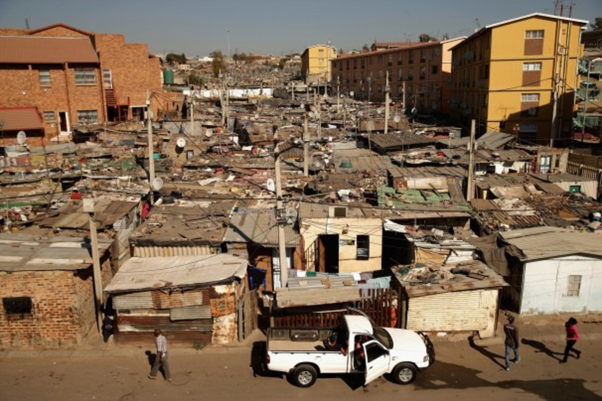 The South African township of Alexandra, shown above, is next to the wealthy suburb of Sandton, an example of post-apartheid South Africa's vast gulf between rich and poor.