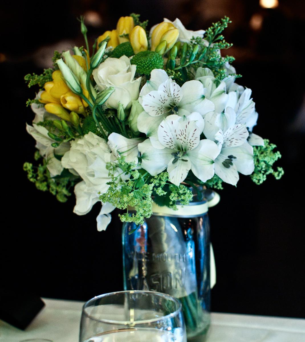 Mason jars make whimsical vases for real or fake flower bouquets.