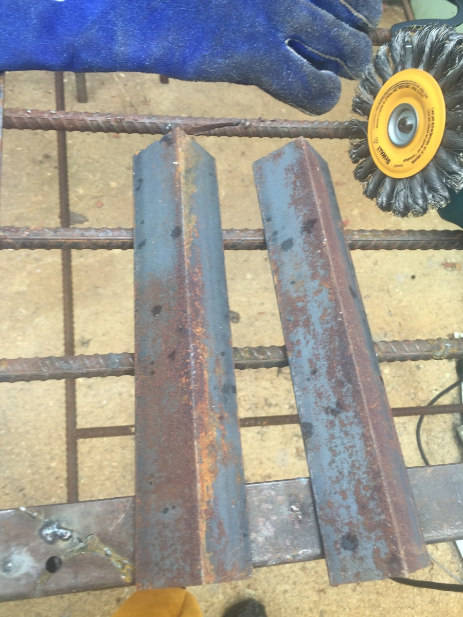 Left over angle iron scraps to be converted into support brackets for a wooden work table.
