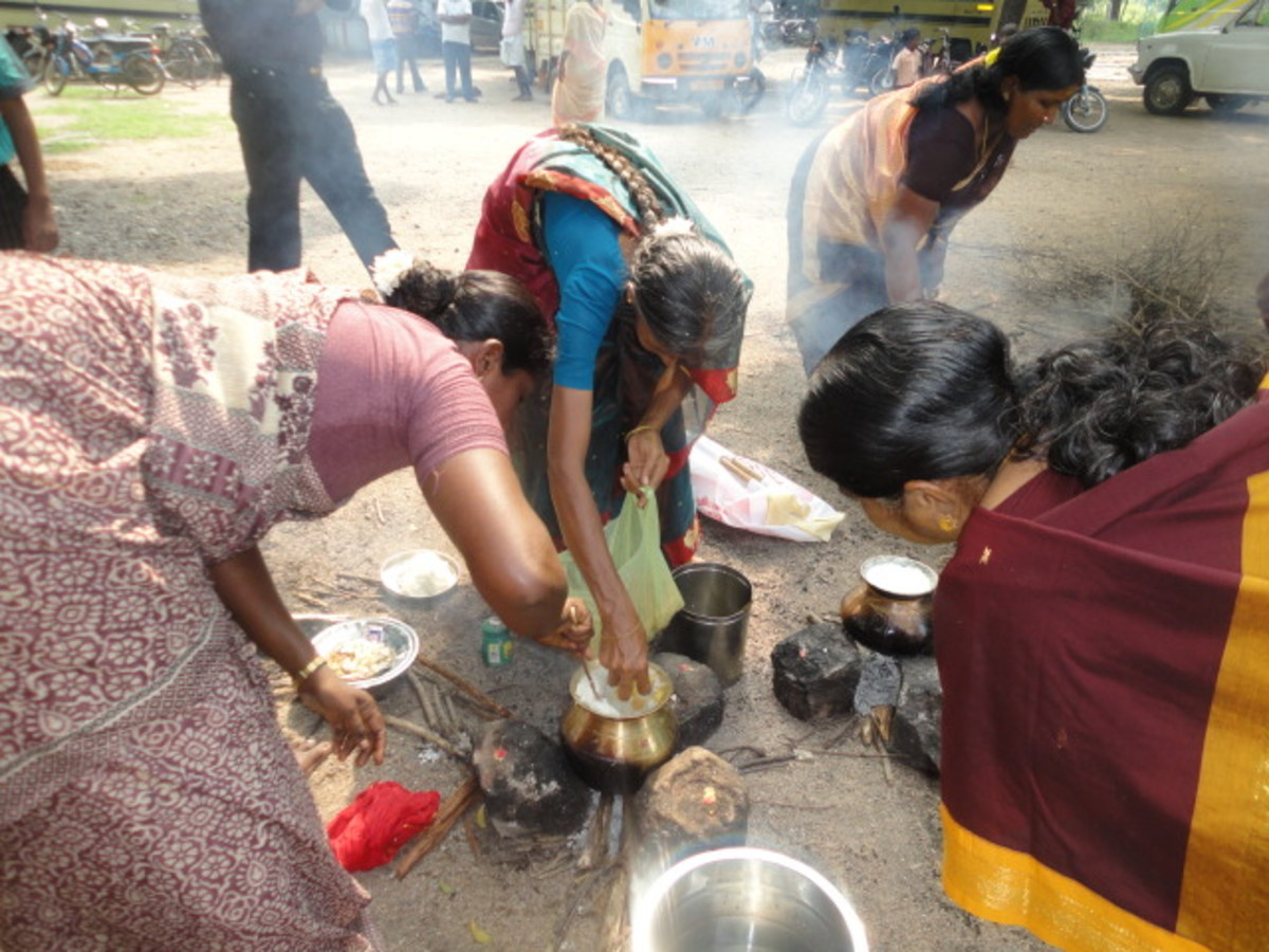 women making pongal at a temple