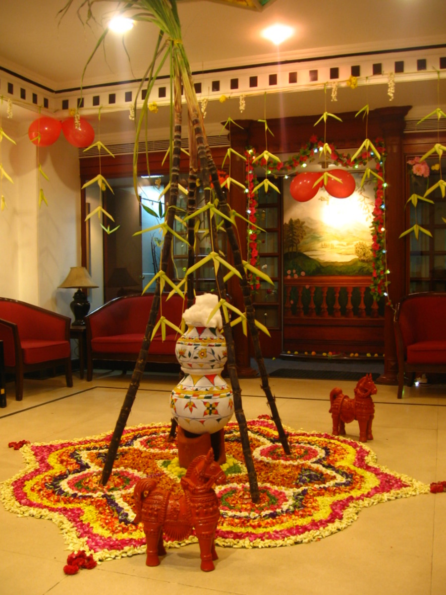 the traditional pongal celebration with pots, sugarcane & leaves and flowers in an office
