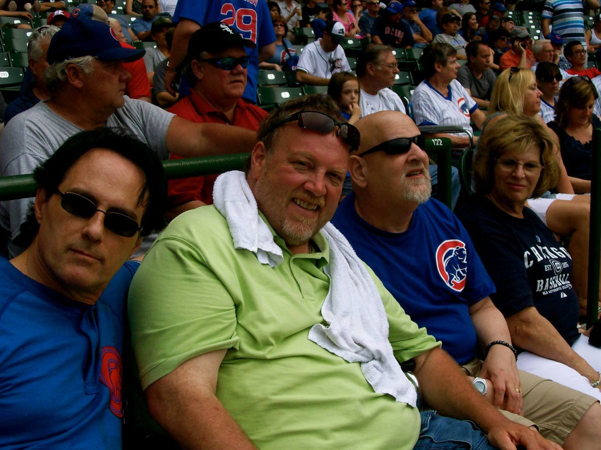 Jim Watkins, Dale Parsons (personal manager of the White Summer band), Jimmy Schrader and his wife Barbara Schrader at Wrigley Field (2013)