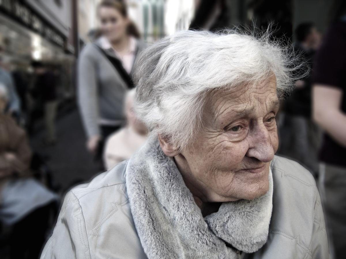 Woman with gray hair and wrinkled skin