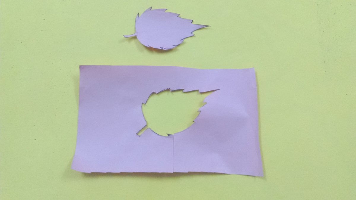 Now use a pair of  scissors to cut out the leaf from the paper.