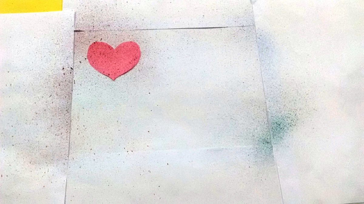 Cover the margin with regular papers and use paper cutouts of your choice. Here I have used a Heart.