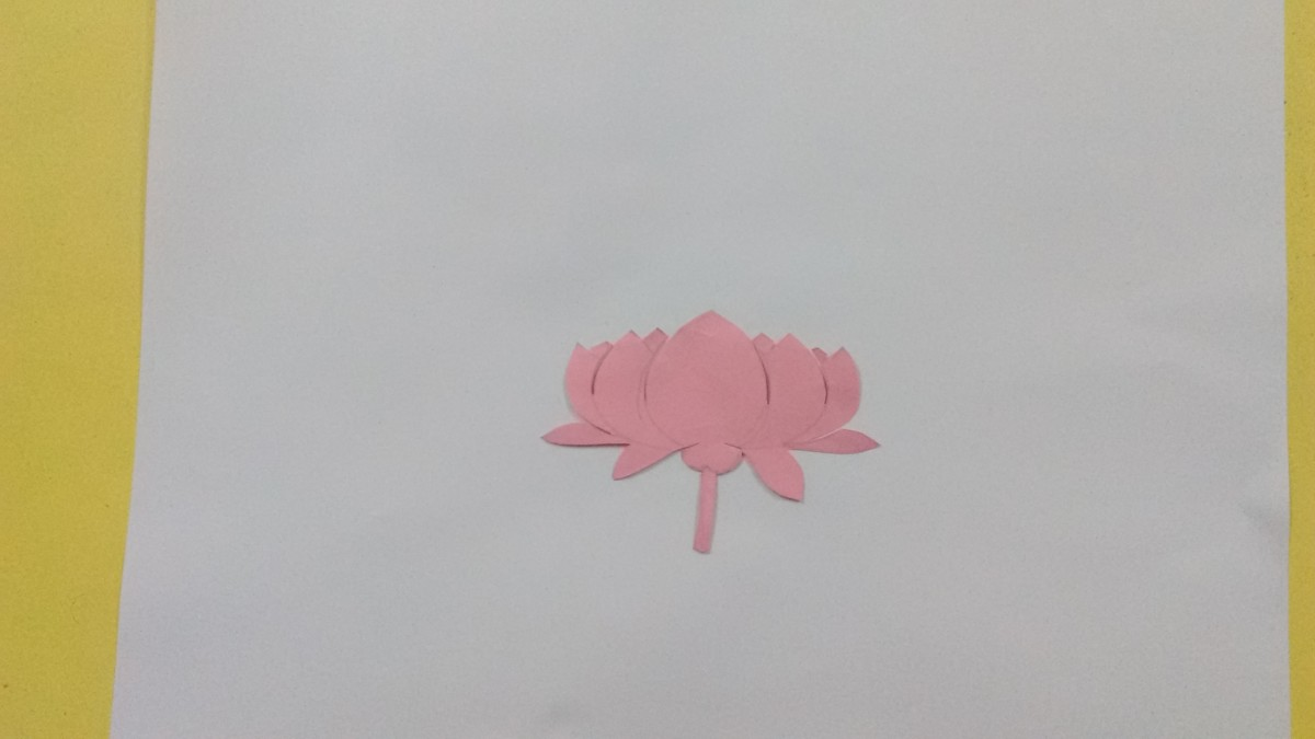 Let us use a flower cutout for spraying. Draw a lotus on a paper and then cut it out from the paper.