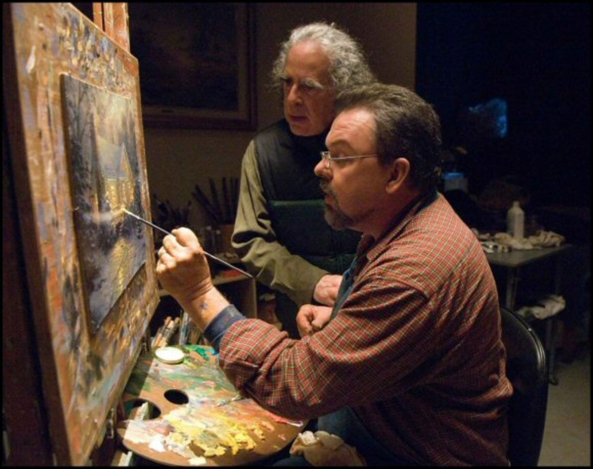 "Movie Director Michael Campus watches Thomas Kinkade working on his painting ""The Christmas Cottage"""