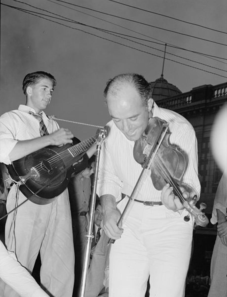 """Musicians in Cajun band contest, National Rice Festival, Crowley, Louisiana. Most of the music was of the folk variety accompanied by singing."" 1938. Shown are musicians playing violin and steel guitar."