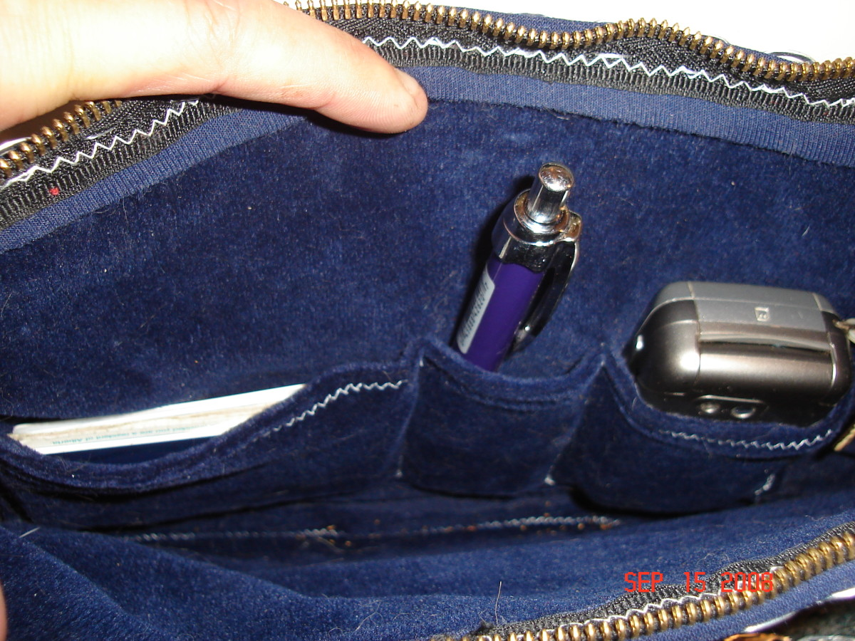 The inside of my purse, soft velvet and with 3 pockets