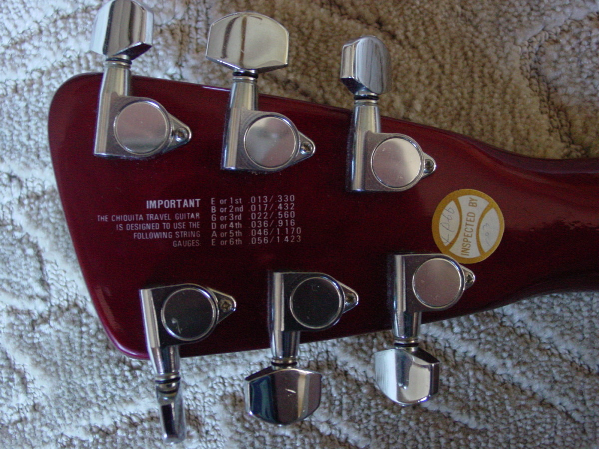 Back of headstock with printed recommended string gauges