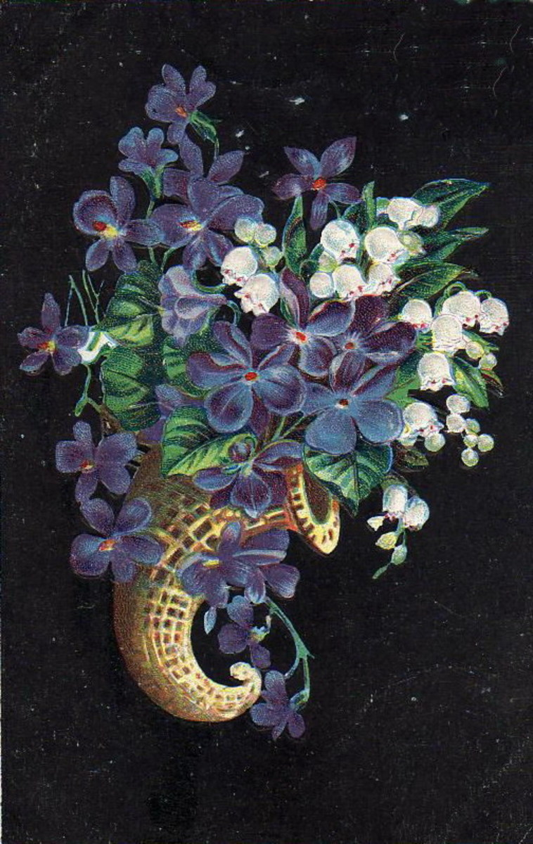 Blue and white flowers in a horn basket clip art
