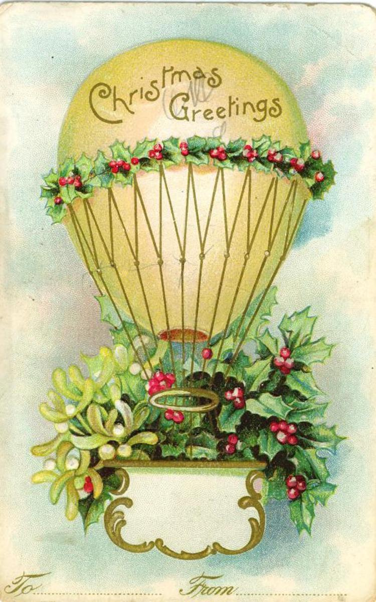 "Vintage hot air balloon with holly, mistletoe and ""Christmas Greetings"" message"