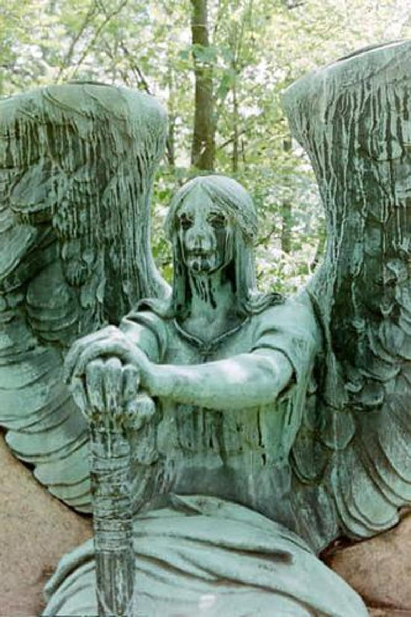 "The sculpture is named ""Angel of Death Victorious"". He sits at the grave with an overturned Torch....Wings spread....Guardian of the Dead"
