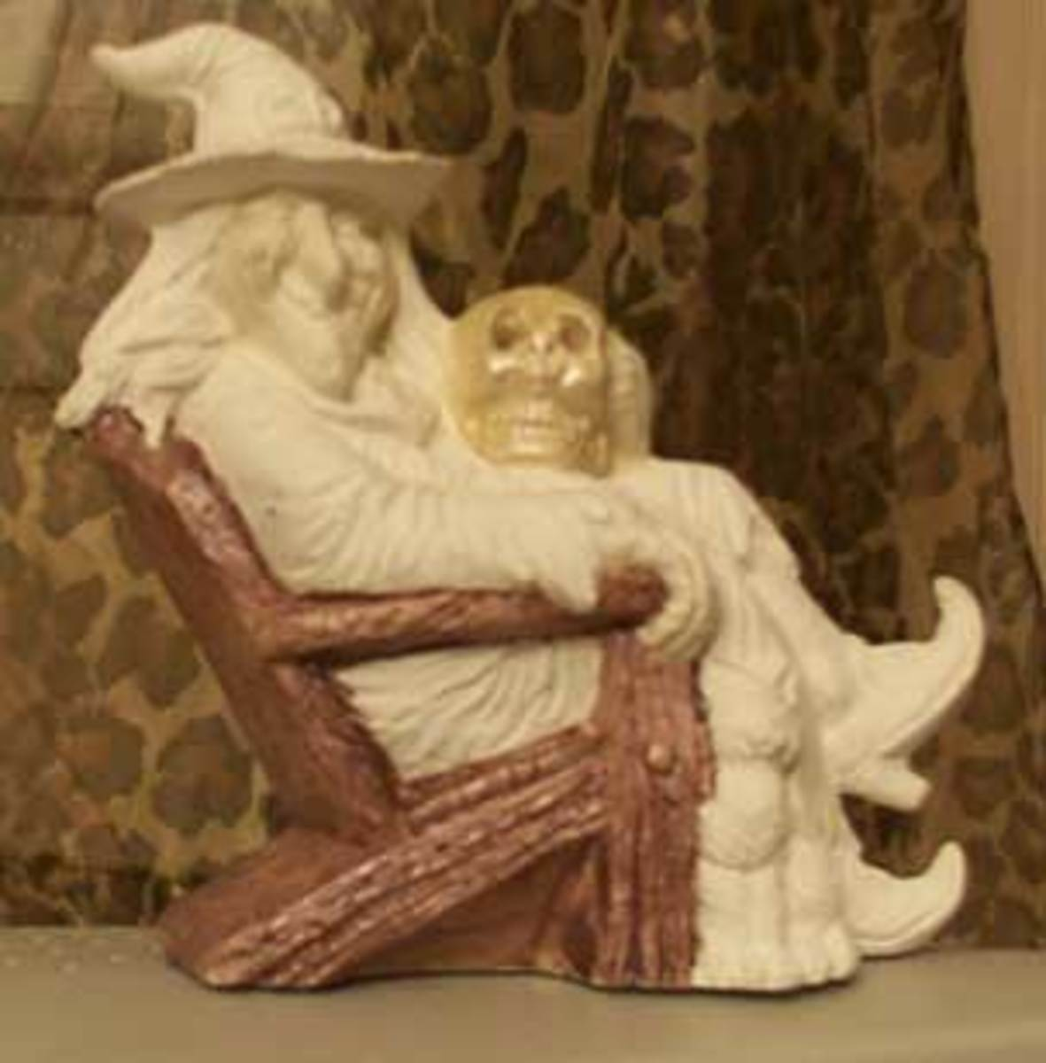 I painted the chair first with a flat coat for later antiquing and dry brush. I painted the skull with pearl white, hoping to get a crystal effect--hard to do with ceramic.