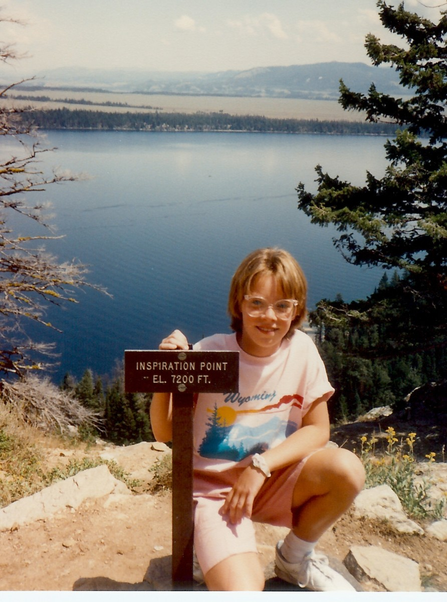 My niece at Inspiration Point.  Jenny lake lies below as well as the valley floor with Jackson Hole.