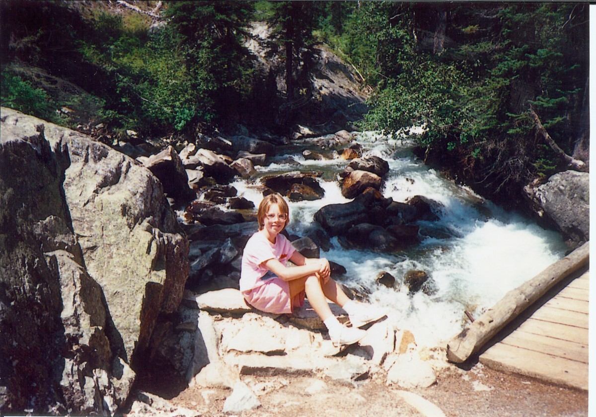 My niece posing by the rushing river.