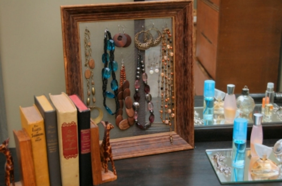 A beautiful accent - unpainted and without any fabric backing, I made hooks from paper clips to hang necklaces on.