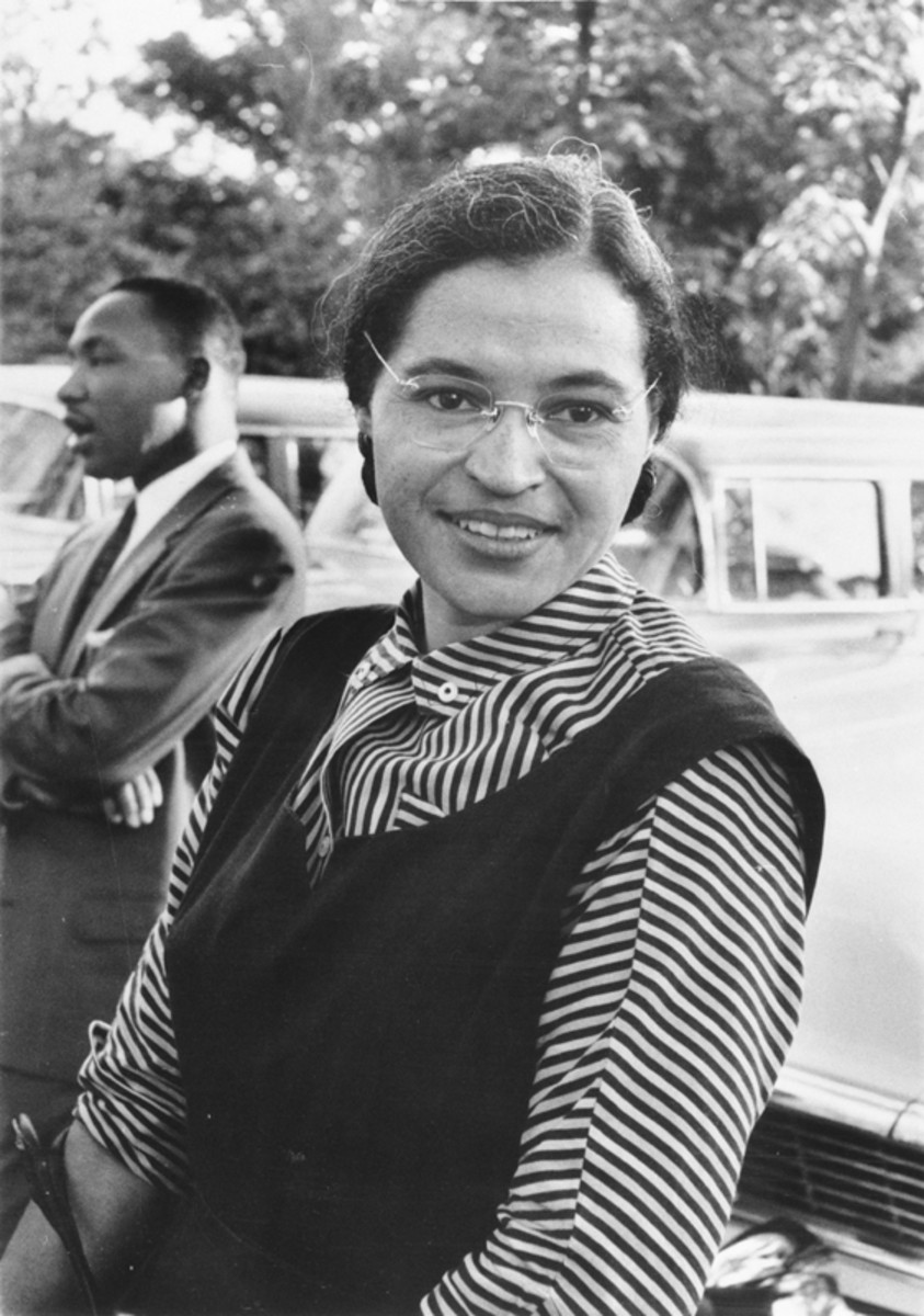 Rosa Parks with Martin Luther King Jr in the background