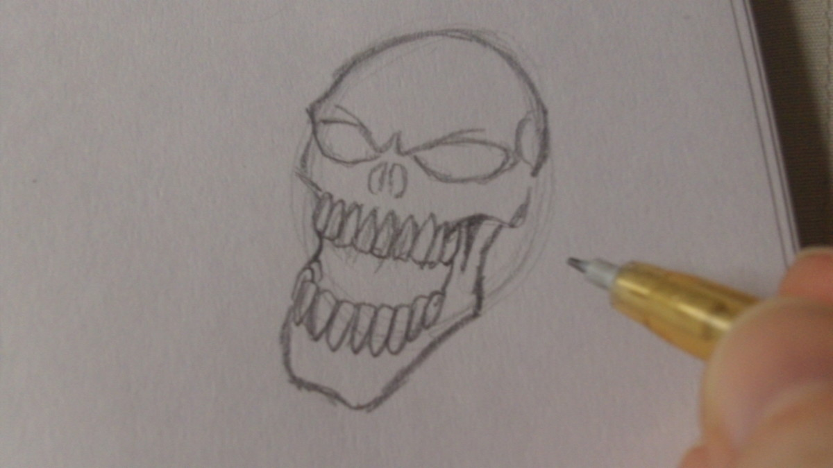 Draw in the bottom teeth and lower jaw