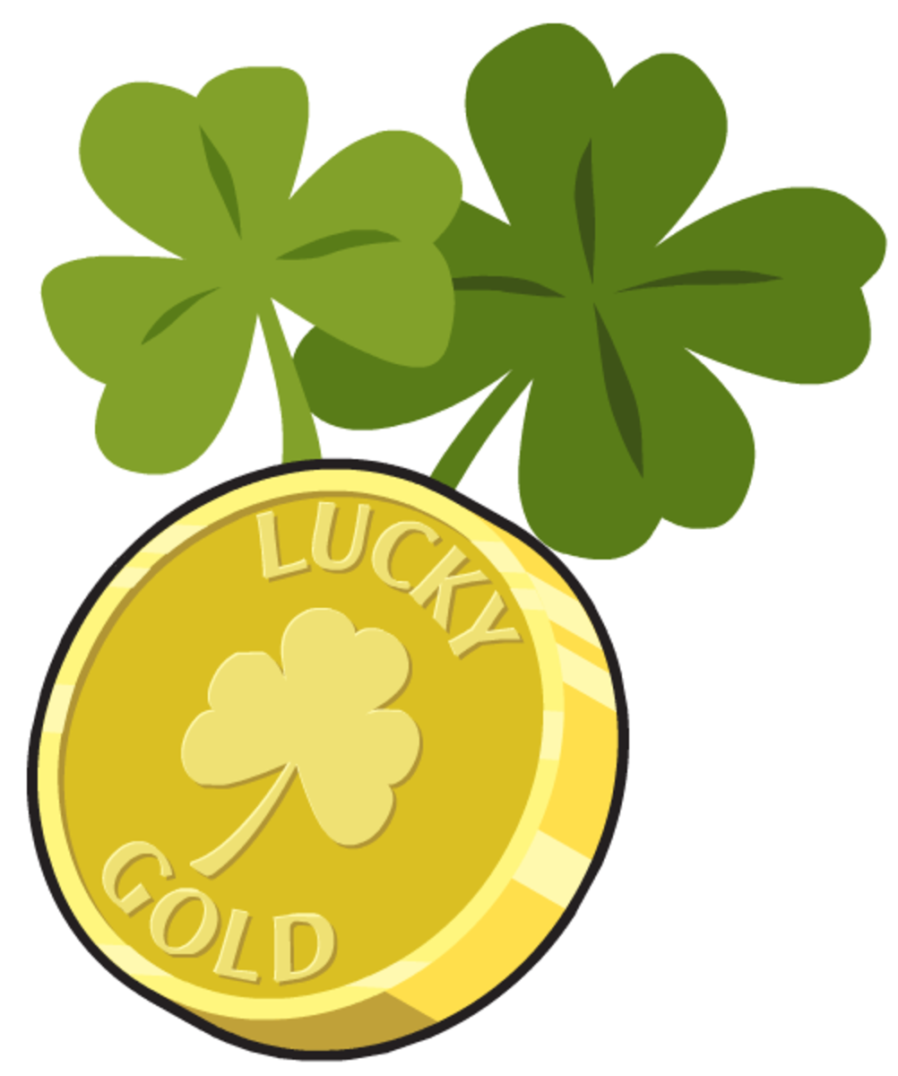 Lucky gold coin with two green St. Patrick's Day shamrocks
