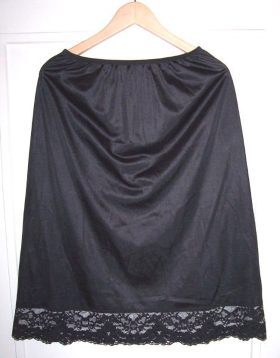 A black Vassarette vintage half slip with lace trim at the hem from the photos of Geneviève on Wikipedia