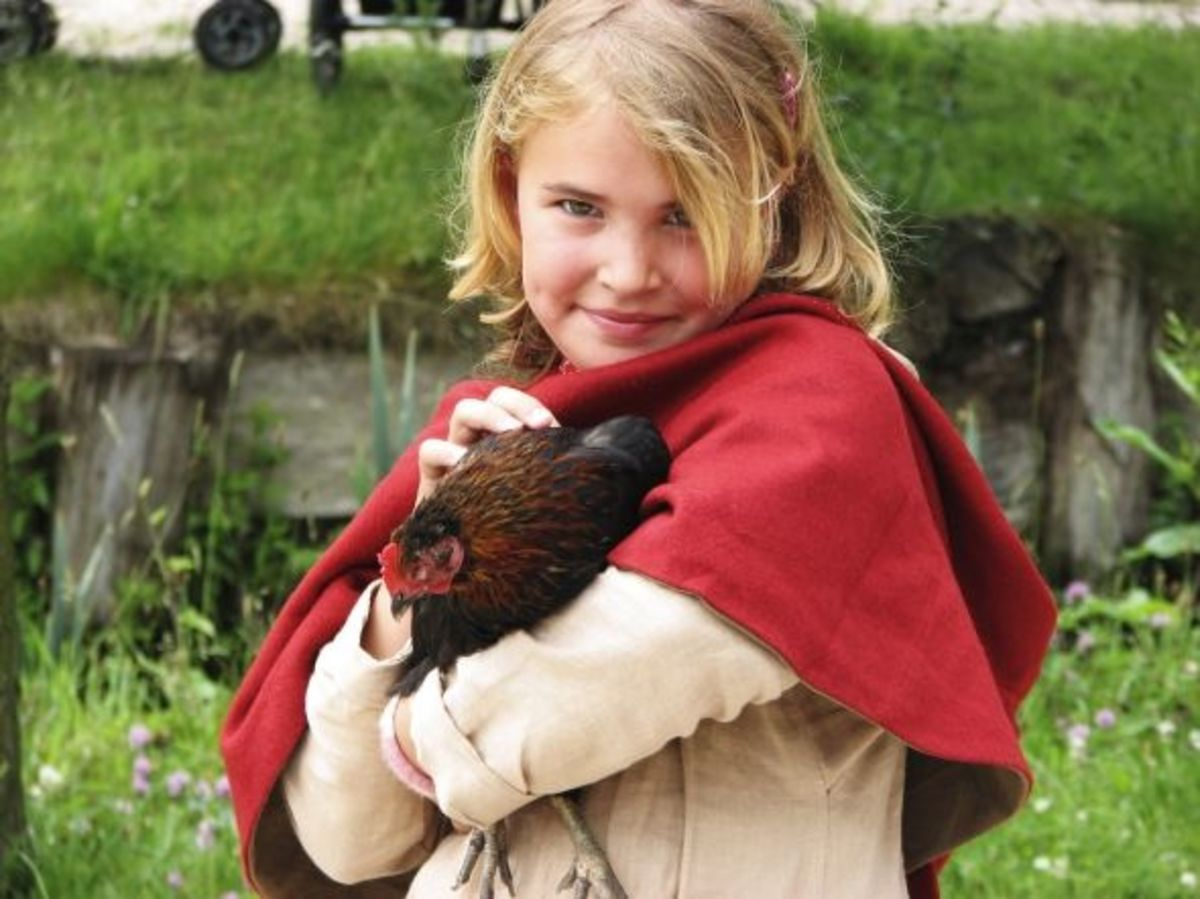 A girl and her pet chicken