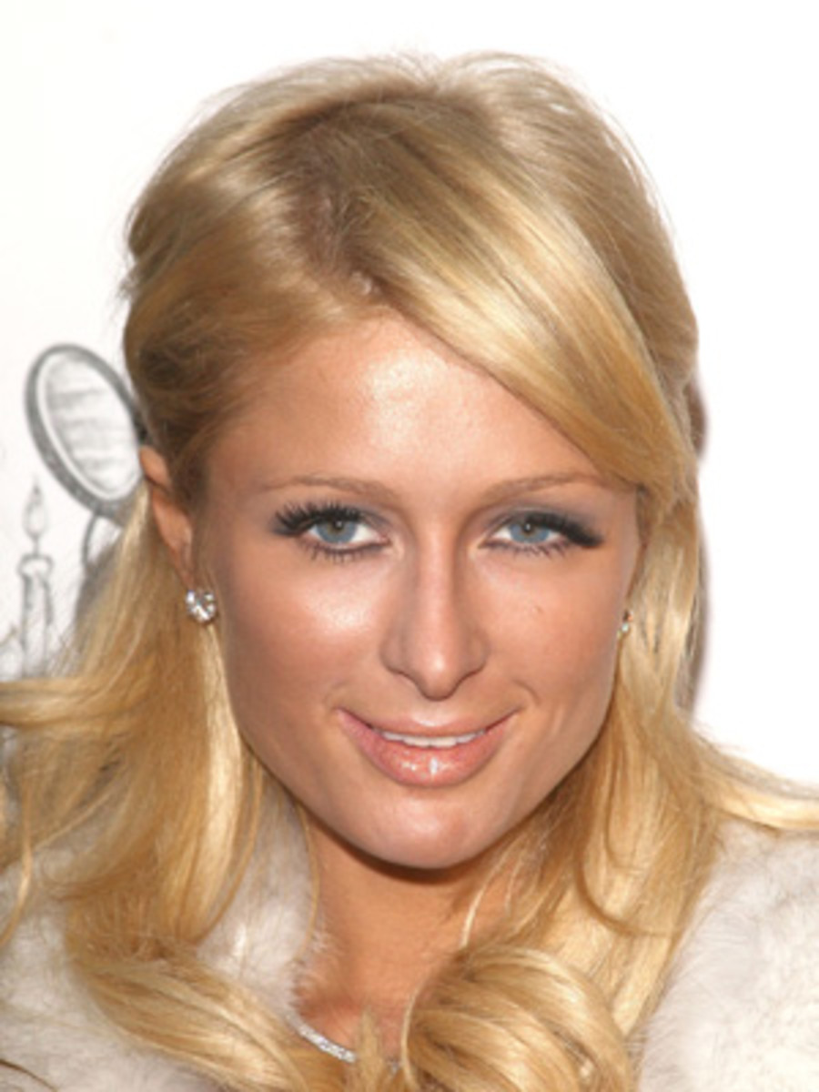 Paris Hilton...Ummmm, No. Sorry Paris, but you don't really  qualify for this part... By the way, is that a ZIT on her chin? (And a condom behind her ear?)