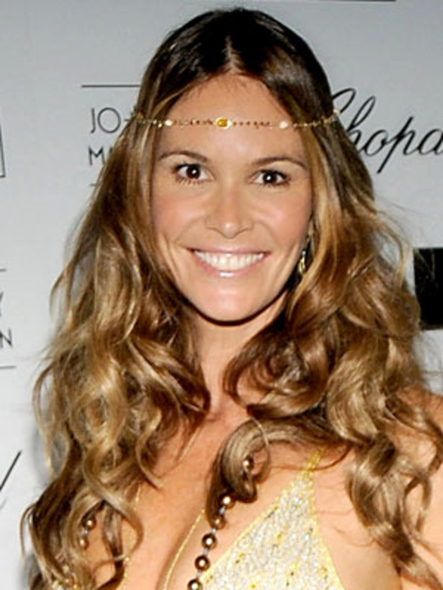 Elle Macpherson...      Pretty girl, but defenately not the right hairstyle for her long face...