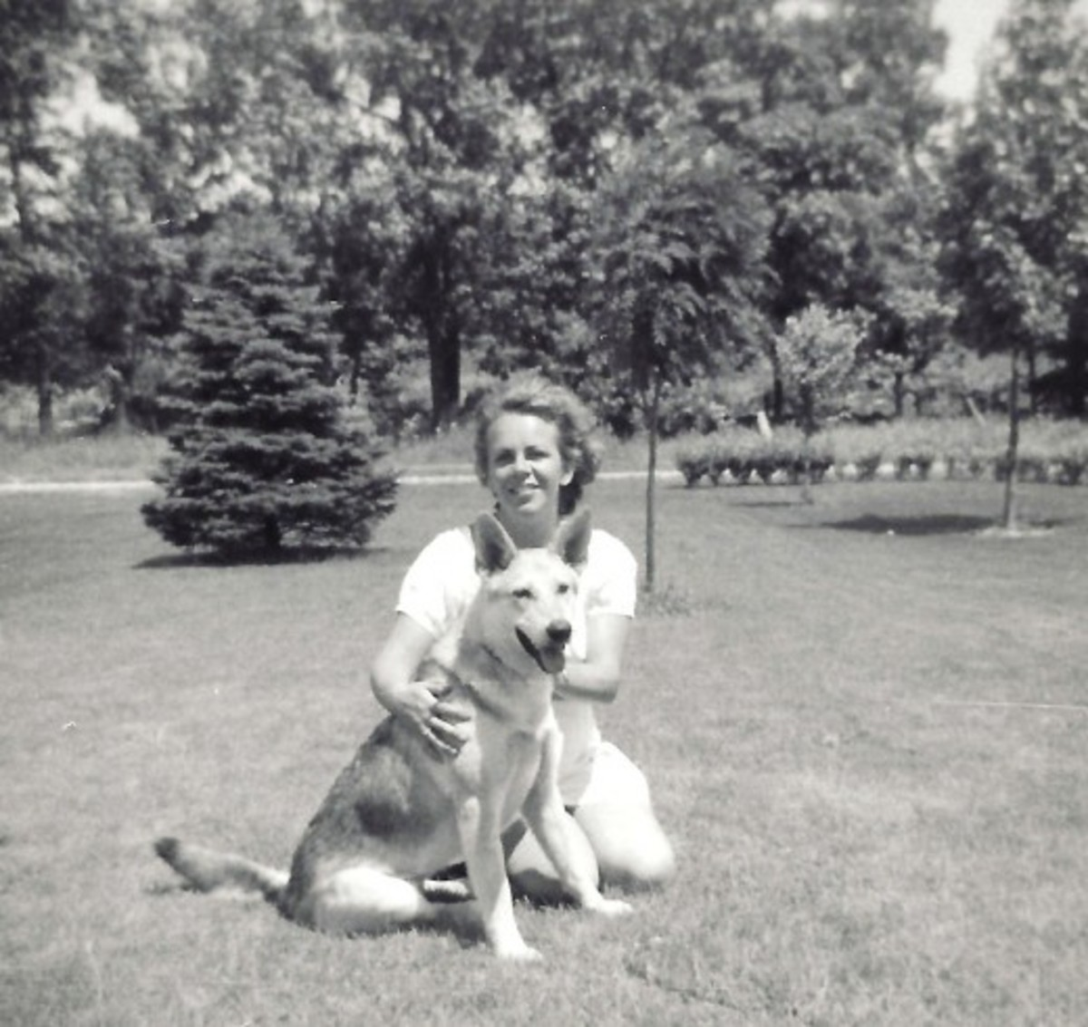 Photo of my mother and very first German Shepherd named Sheba.