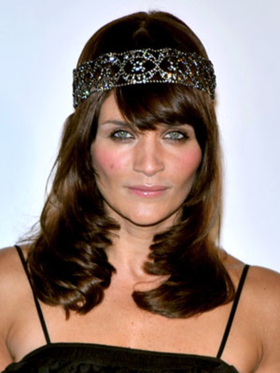 Helena Christensen... No...no...NO! Face is too long, and she's sucking her cheeks in too much, like a two year old trying not to smile...
